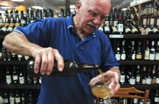 Carl Raskin pours a craft beer during a recent tasting at his elegance wine and antiques shop in Grants Pass, Ore. Craft brews are the fastest-growing segment of the beer industry.