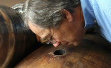 Brewmaster Larry Sidor takes a whiff of an experimental beer at the Deschutes Brewery in Bend, Ore.
