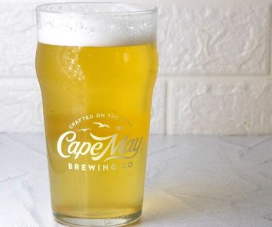 "Cape May, NJ -- Cape May Brewing Company is pleased to announce a new, year-round addition to their line of core brands. Cape May White, a Belgian-style wheat ale brewed with coriander and orange peel, is currently available on draft and will be available in 12-ounce cans throughout New Jersey, Eastern Pennsylvania, and Delaware later this month. ""We're extraordinarily excited about our newest core brand,"" says Cape May Brewing Company CEO and co-founder, Ryan Krill. ""Keeping true to our commitment to variety and innovation, we wanted to bring something new and alluring to the market that will appeal to discriminating fans of Belgian-style beers. We're happy to present Cape May White: a refreshing alternative in this category."" Cape May White began its journey as Cape May Brewing Company's award-winning Great Wit Shark, having won a silver medal in the Belgian Wit category at the 2019 United States Beer Tasting Championships. Since then, Cape May Brewing Company has been perfecting the recipe for Cape May White. ""We found ourselves with a gap in our core offerings and wanted to fill it with something exciting and new,"" says Director of Sales, Bill Zaninelli. ""Our sales team had been requesting a true witbier for years, and, as Great Wit Shark had been well-received on draft, this seemed like the perfect chance to scale up a trusted brand and fill a need in the market."" Keeping with the styling of Great Wit Shark, the branding for Cape May White is firmly rooted in shark imagery, with shark's teeth lining the border of the can and a shark's jaw comprising the primary visual concept. ""As a shore brewery, we incorporate coastal iconography into much of our branding,"" says Director of Marketing, Alicia Grasso, ""and shark sightings can bring a sense of excitement to a typical summer season. While Cape May White is extraordinarily approachable, we feel that this beer will bring some much-needed excitement to a category that has seen little change over the years."" Designed as a traditional witbier, Cape May Brewing Company employed a predominantly wheat grain bill, a robust Belgian yeast, and added coriander and orange peel to the boil. ""It's incredibly well-balanced,"" says Cape May Brewing Company Innovation Director, Brian Hink. ""Zesty, refreshing, and crisp, Cape May White has excellent citrus notes, a fruity and intriguing yeast profile, and a light mouthfeel without feeling thin or watery. It's refreshing and quaffable with a ton of underlying characteristics that are fun and inviting."" Cape May White is currently available on draft in New Jersey and Eastern Pennsylvania and will be available in Delaware as part of Cape May Brewing Company's expansion into the state. 12-ounce cans will hit the shelves at the end of this month. For more information on Cape May Brewing Company, including for tours and tastings, see www.capemaybrewery.com or call (609) 849-9933. ### About Cape May Brewing Company: CMBC started in 2011, with three guys making one beer in a 1,500 square-foot space. Now, they've got over 32,000 square feet of space at the Cape May Airport and several hundred flagship, seasonal, and small-batch brews under their umbrella, distributed throughout all of New Jersey and Eastern Pennsylvania. Their original space is now dedicated to experimental brewing and their award-winning Tasting Room, with a separate, industrial brewing facility across the street. For more information, see Cape May Brewing Company's website at www.capemaybrewery.com or call (609) 849-9933."